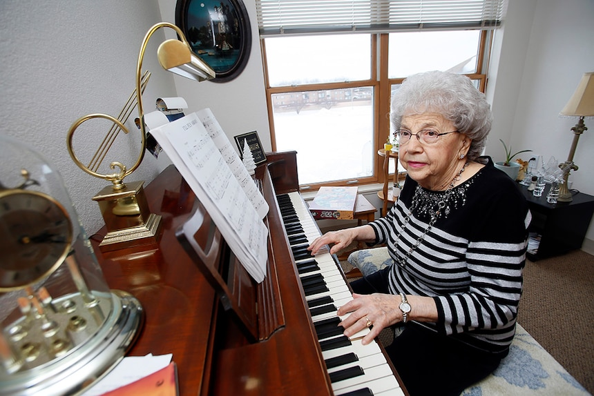 Eleanor Braaten, a former music teacher, enjoys playing her piano in her two-bedroom assisted living apartment at Elim's Pioneer House in Fargo, N.D. Photo: Dave Samson