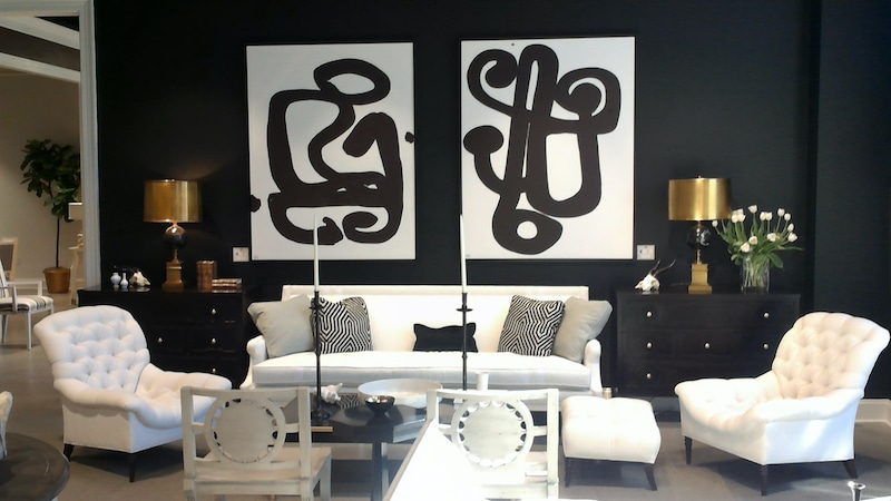 Classic black walls and white upholstery, coupled with bold black and white art made this room.