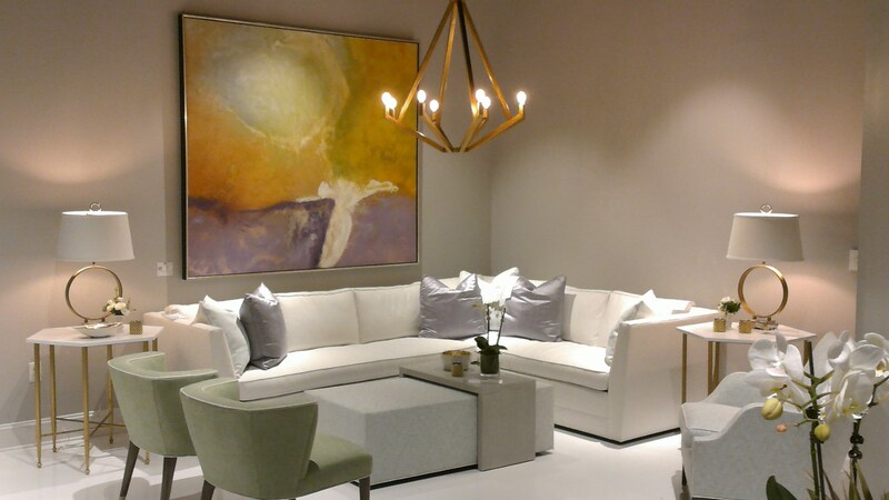 Neutral furnishings were transformed by art. What would this have looked like without this art?